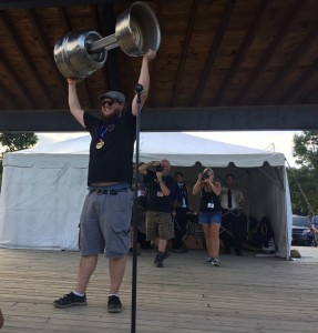 Brandon Tolbert of The Answer Brewpub hoists the Virginia Brewers Cup Best in Show trophy at the Virginia Craft Brewers Fest in Nelson County.