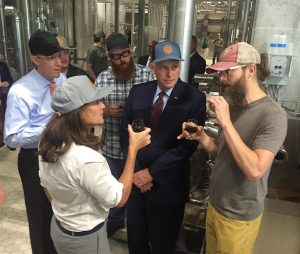 Greg Koch (right), co-founder and CEO of Stone Brewing Co., shares a sample of the imperial stout wort with (from left) Todd Haymore, Virginia secretary of agriculture and forestry; First Lady Dorothy McAuliffe; Peter Weins of Stone; and Virginia Governor Terry McAuliffe. Photo by Lee Graves