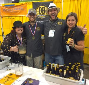 The Devils Backbone crew at the Great American Beer Festival includes Dizzle Clark (from left), taproom manager; Wade Hughes, pathfinder; Matt Castoro, senior brewer; and Heidi Crandall, co-founder. Photo  by Lee Graves